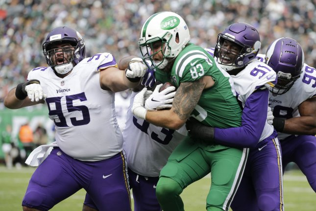 The New York Jets' Eric Tomlinson is tackled by Minnesota Vikings defender Stephen Weatherly and David Parry in the first half on October 21 at MetLife Stadium in East Rutherford, N.J. Photo by John Angelillo/UPI