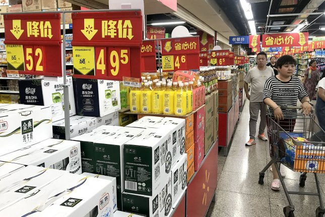 Shoppers browse products on July 15 at a Walmart in Beijing, China. Photo by Stephen Shaver/UPI