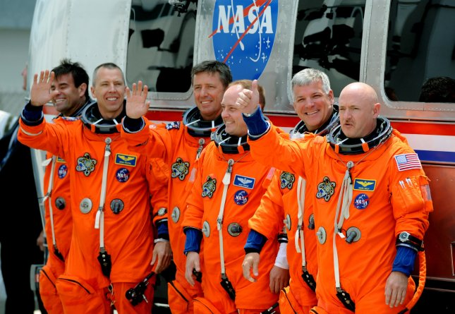 Space Shuttle Endeavour Commander Mark Kelly (right) gives the thumbs up after departing with his crew and boarding the Astrovan on their way to the launchpad for Endeavour's last flight at Kennedy Space Center on April 29, 2011. The launch attempt was scrubbed minutes later. Behind Kelly is Pilot Greg Johnston and mission specialists Mike Finke and Roberto Vittori, Drew Feustel, and Greg Chamitoff (left). Kelly is the husband of Arizona Congresswoman Gabrielle Giffords, who was recovering from an assassination attempt and at the Cape to watch the possible liftoff. UPI/ Pat Benic