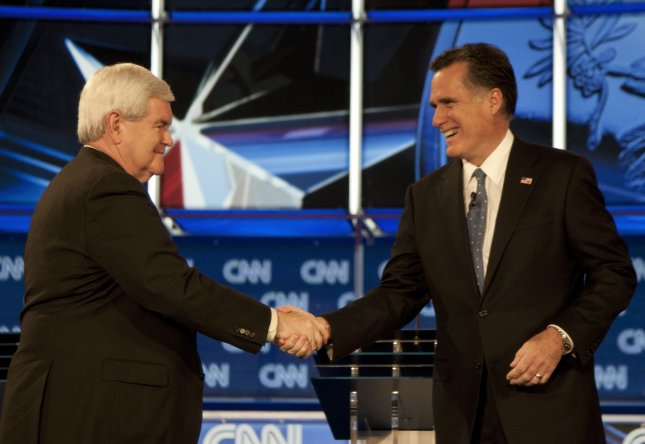 Newt Gingrich (L) and Mitt Romney greet each other prior to the CNN Florida Republican Presidential Debate at the University of North Florida in Jacksonville, Florida on January 25, 2012. This is the final debate prior to the Florida primary. UPI/Mark Wallheiser