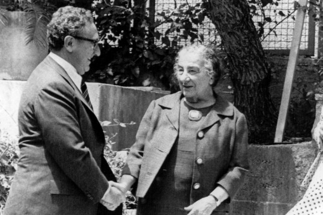 U.S. Secretary of State Henry Kissinger shakes hands with outgoing Israeli Prime Minister Golda Meir on May 2, 1974. Ms. Meir was elected the the fourth Prime Minister of Israel, and the first female to hold the position. UPI File Photo