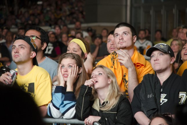 Fans watch as the Pittsburgh Penguins fall two goals behind the San Jose Sharks in the third period of the 4-2 Penguins loss at the Consol Energy Center during game five of the Stanley Cup Finals in Pittsburgh on June 9, 2016. Photo by Archie Carpenter/UPI