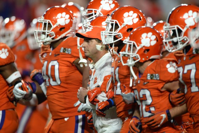 Clemson Tigers head football coach Dabo Swinney leads his team out on the field prior to the 2016 College Football Playoff National Championship. Photo by Jon SooHoo/UPI