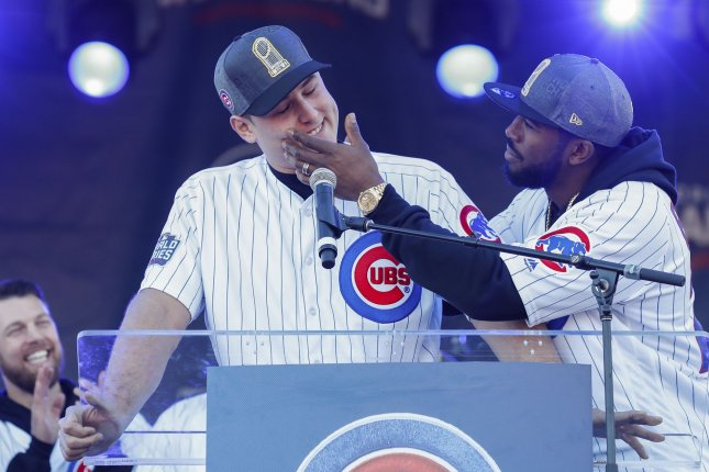 Chicago Cubs' Dexter Fowler (R) checks on Anthony Rizzo (L) as he tears up while speaking during the 2016 World Series Champion celebration rally at the Grant Park on November 4, 2016 in Chicago. The Cubs won the World Series for the first time in 108 years. Photo by Kamil Krzaczynski/UPI