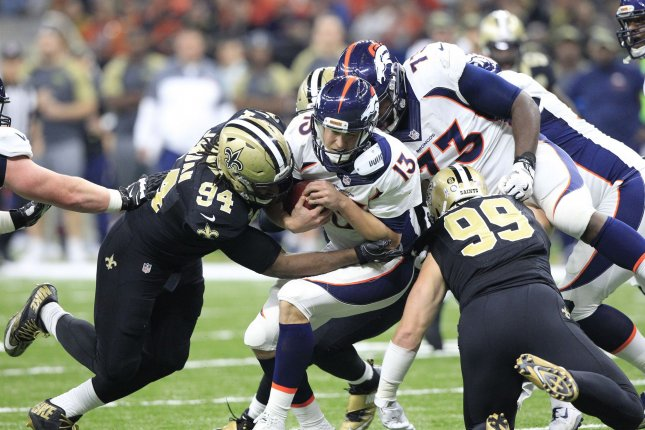 Denver Broncos quarterback Trevor Siemian (13) is sacked for a 4 yard loss by New Orleans Saints defensive end Cameron Jordan (94) in the first quarter against the New Orleans Saintsat the Mercedes-Benz Superdome in New Orleans November 13, 2016. File photo by AJ Sisco/UPI