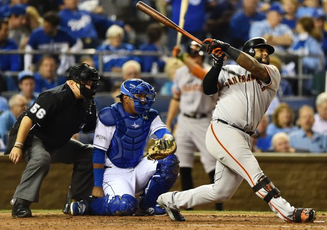 Pablo Sandoval of the San Francisco Giants hits a double against the Kansas City Royals in the 2014 World Series. Photo by Kevin Dietsch/UPI