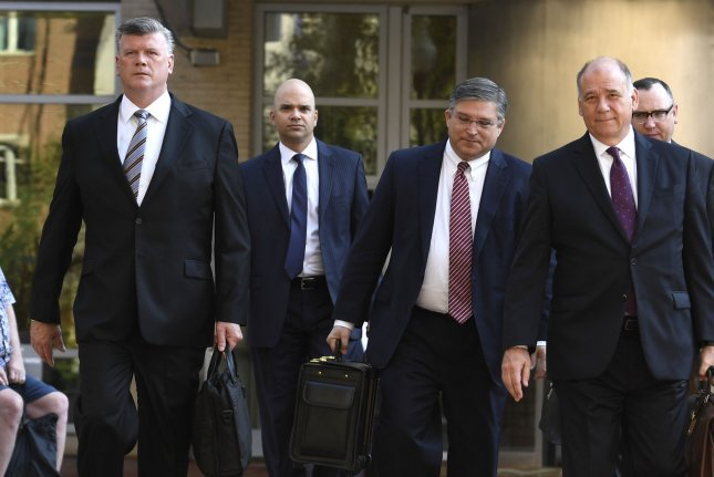Attorneys Kevin Downing Thomas Zehnle and the defense team for Paul Manafort walk into the Albert V. Bryan Federal Courthouse in Alexandria, Va., Wednesday. Photo by Mike Theiler/UPI