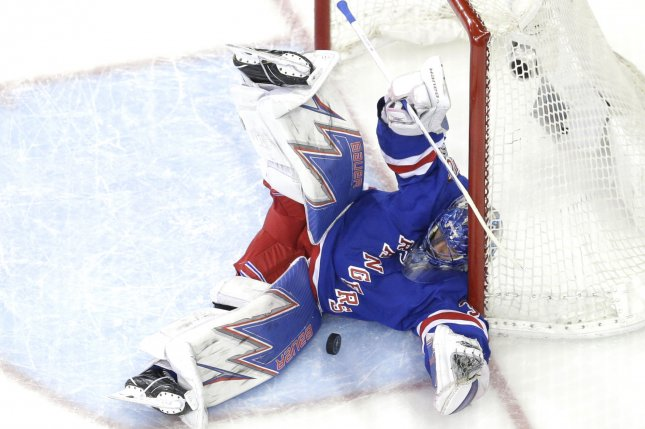 Henrik Lundqvist and the New York Rangers face the New York Islanders on Thursday night. Photo by John Angelillo/UPI