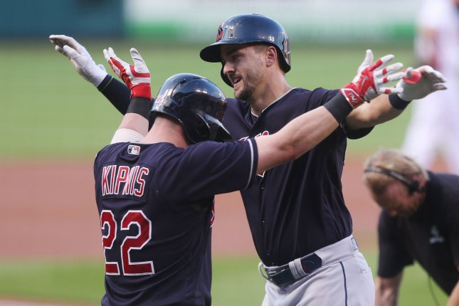Former Cleveland Indians outfielder Lonnie Chisenhall celebrates his solo home run with Jason Kipnis at home plate in the second inning on June 27 at Busch Stadium in St. Louis. Photo by Bill Greenblatt/UPI