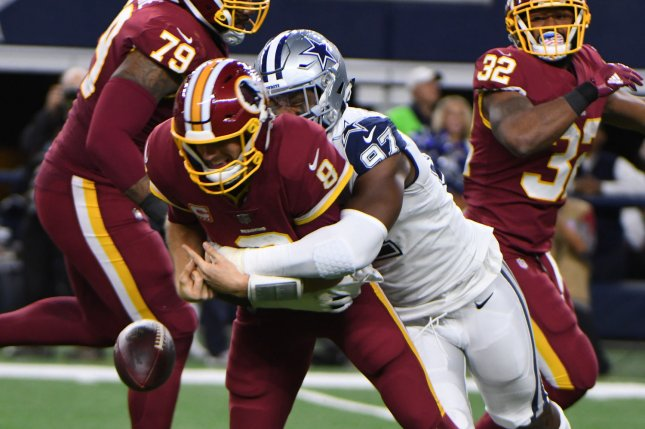 Former Cowboys defensive lineman Taco Charlton (97) was released by Dallas last season. The Miami Dolphins claimed him off waivers in September. File Photo by Ian Halperin/UPI