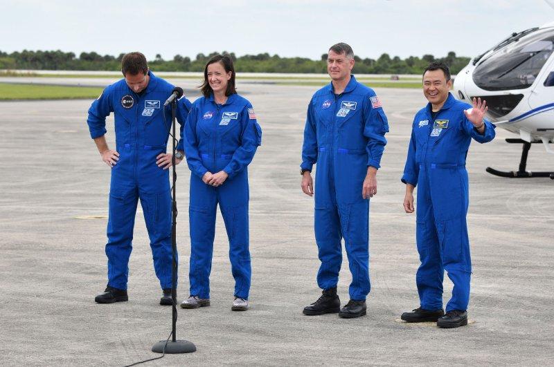 ESA astronaut Thomas Pesquet (L to R), NASA astronauts Megan McArthur and Shane Kimbrough, and Japanese astronaut Akihiko Hoshide pose for the media at the Kennedy Space Center in Florida on Friday. Photo by Joe Marino/UPI