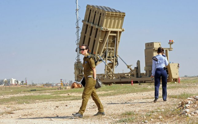 Israeli soldiers stand near the Iron Dome, a new anti-rocket system, stationed near the southern city of Beersheba, Israel, March 27, 2011. The Israeli Defense Force deployed the $200 million Iron Dome system in response to dozens of rockets fired by Palestinian militants from Gaza in the past weeks. The Iron Dome is meant to protect Israeli towns from rockets fired from Gaza. UPI/Debbie Hill