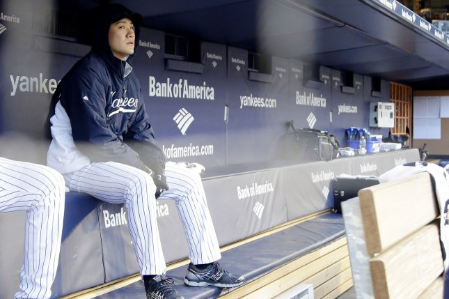 New York Yankees starting pitcher Masahiro Tanaka sits in the dug on Jackie Robinson Day in game 2 of a double header against the Chicago Cubs at Yankee Stadium in New York City on April 16, 2014. UPI/John Angelillo