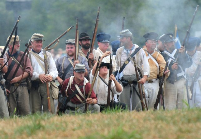 Confederate soldiers await orders, during a Civil War re-enactiment in Manassas, Va., July 24, 2011. UPI/Kevin Dietsch/File