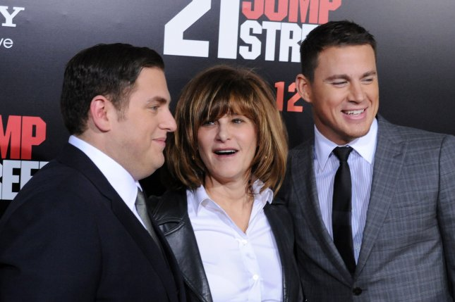 Amy Pascal, center, with actors Jonah Hill, left, and Channing Tatum in 2012. File Photo by Jim Ruymen/UPI