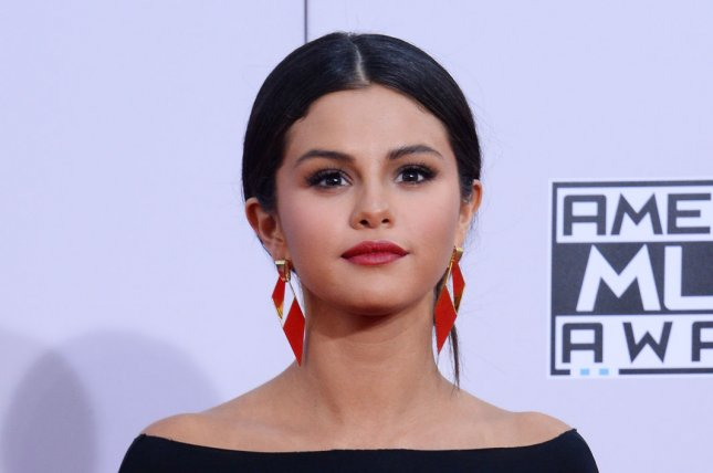 Singer and actress Selena Gomez arrives for the 42nd annual American Music Awards in Los Angeles on Nov. 23, 2014. Photo by Jim Ruymen/UPI