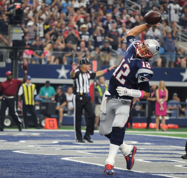 New England Patriots Tom Brady scores on a one-yard quarterback keeper against the Dallas Cowboys during the first half at AT&T Stadium on October 11, 2015 in Arlington, Texas. Photo by Ian Halperin/UPI