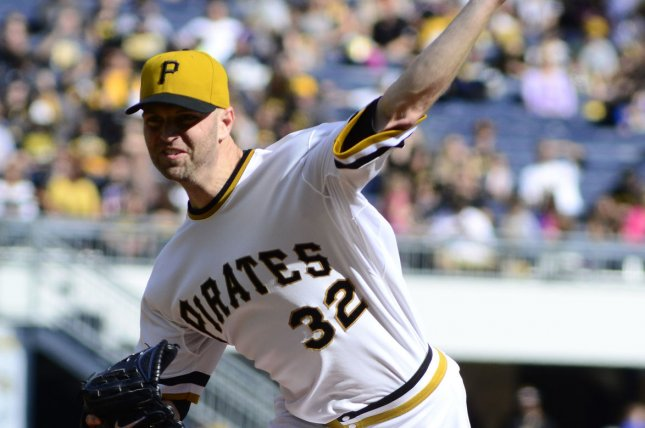 Pittsburgh Pirates starting pitcher J.A. Happ (32) throws in the first inning against the Cincinnati Reds at PNC Park in Pittsburgh on October 4, 2015. Photo by Archie Carpenter/UPI