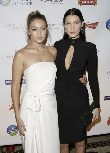 Gigi Hadid, left, and sister Bella Hadid at the Global Lyme Alliance Inaugural Gala on Oct. 8. The model said she is protective of Bella in a recent interview. File Photo by John Angelillo/UPI