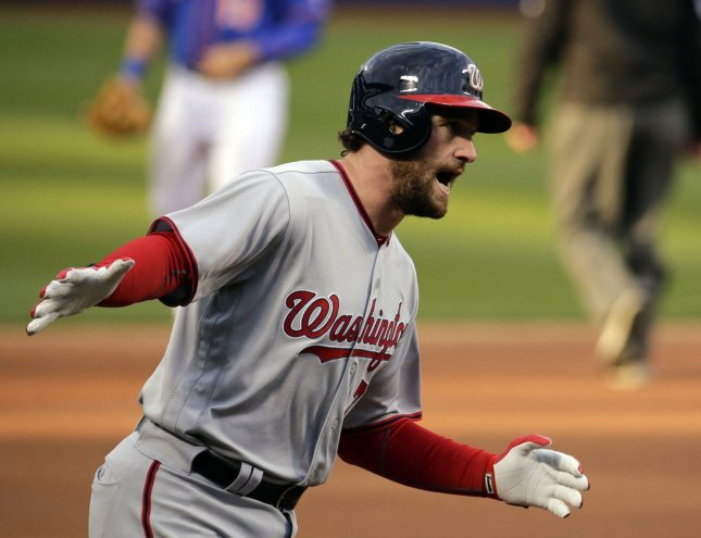 Washington Nationals batter Daniel Murphy reacts after hitting a two-run home run against New York Mets starting pitcher Matt Harvey in New York City on May 19, 2016. The Nationals not only improved their lineup but also potentially hurt their NL East chief competitor, the New York Mets, by bringing Murphy over on a three-year contract worth $37.5 million. Photo by Ray Stubblebine/UPI