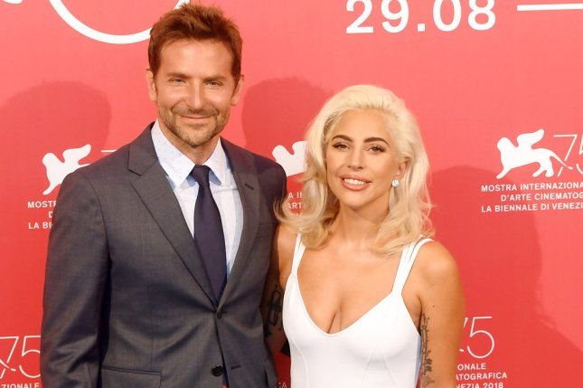 Lady Gaga (R) and Bradley Cooper attend a Venice Film Festival photocall for A Star is Born on Friday. Photo by Rune Hellestad/UPI