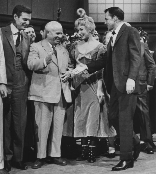 Frank Sinatra greets then Soviet Premier Nikita Khrushchev on the set of Can Can September 19, 1959 during Khrushchev's visit to the United States. Also in photo are actor Louis Jourdan (L) and actress Shirley Maclaine. File photo UPI