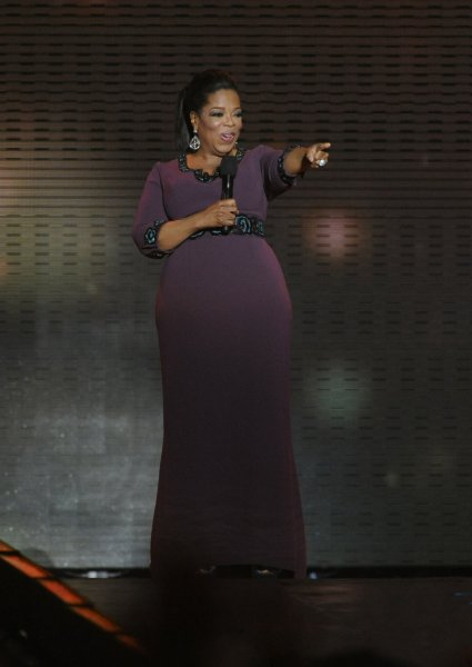 """Oprah Winfrey talks to the audience during the taping of """"Surprise Oprah! A Farewell Spectacular"""" at the United Center in Chicago on May 17. 2011. The show, which featured several surprise celebrity guests, will air over two days, May 23 and 24. Oprah's final show will be a normal episode of The Oprah Winfrey Show taped at Harpo Studios and will air on May 25. UPI/David Banks"""