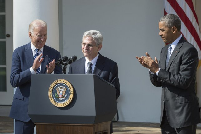 Supreme Court nominee Merrick Garland smiles after being introduced by U.S. President Barack Obama (R) in the Rose Garden of the White House in Washington, DC on March 16, 2016. Judge Garland is a centrist and is nominated to fill the vacancy left by the death of Antonin Scalia. At left is Vice President Joe Biden. Photo by Pat Benic/UPI
