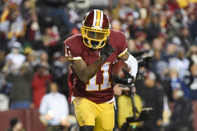 Washington Redskins wide receiver DeSean Jackson (11) celebrates his touchdown during the fourth quarter against the the Dallas Cowboys at FedEx Field in Landover, Maryland on December 7, 2015. Photo by Molly Riley/UPI