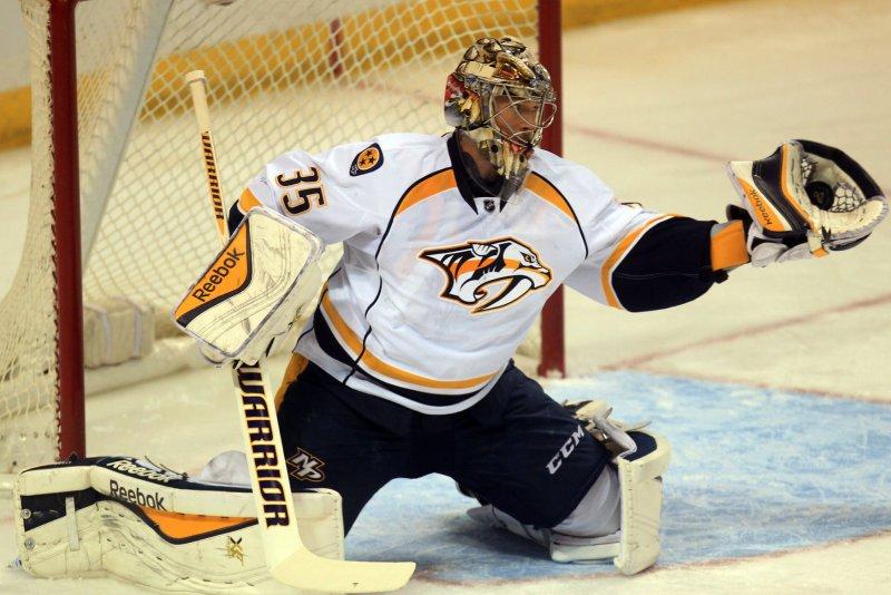 Nashville Predators goaltender Pekka Rinne of Finland makes a glove save. File photo by Bill Greenblatt/UPI