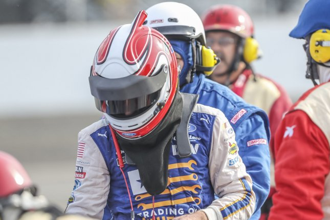 Ryan Blaney gets out of his car following a race. File photo by Bob Ellis/UPI