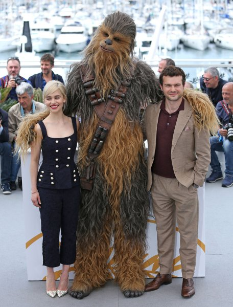 Emilia Clarke (L), Chewbacca (C) and Alden Ehrenreich arrive at a photocall for the film Solo: A Star Wars Story during the 71st annual Cannes International Film Festival in France on May 15. Photo by David Silpa/UPI
