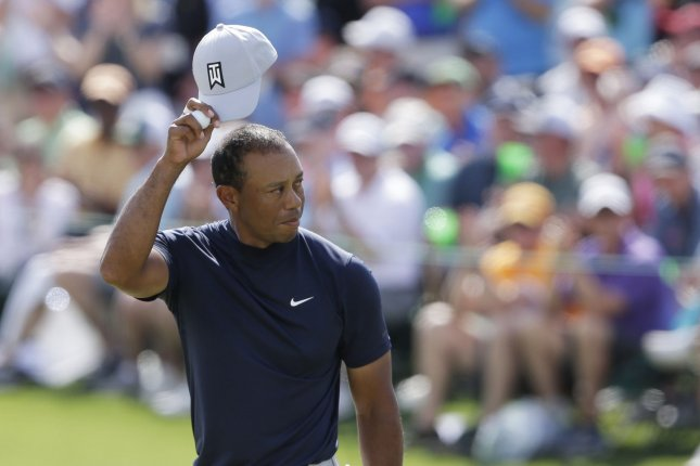 Tiger Woods reacts after his putt for par on the 18th hole in the first round at the 2019 Masters Tournament on Thursday at Augusta National Golf Club in Augusta, Georgia. Photo by John Angelillo/UPI