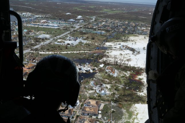 Petty Officer 2nd Class Mike Lewis observes damage in a flight Wednesday over the Bahamas. The Coast Guard is supporting the Bahamian National Emergency Management Agency and Royal Bahamian Defense Force in search and rescue efforts. Photo by Seaman Erik Villa Rodriguez/U.S. Coast Guard/UPI