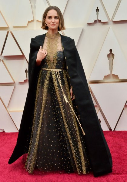 Natalie Portman's Oscars cape featured the names of female directors who were not nominated. Photo by Jim Ruymen/UPI