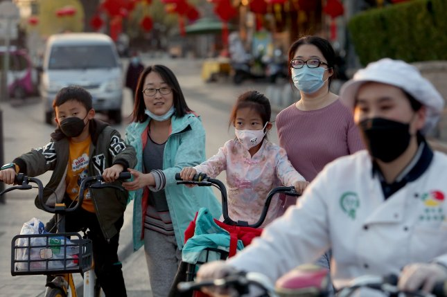 Residents in Beijing, China, wear protective face masks to guard against the coronavirus disease. No new local cases were reported in China on Thursday. Photo by Stephen Shaver/UPI