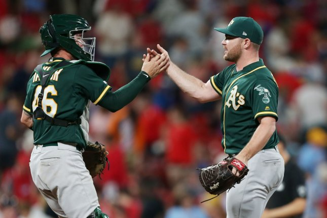 Oakland Athletics pitchers and catchers worked out Sunday in Oakland, Calif., but position players can't join the workouts until they receive COVID-19 test results. File Photo by Bill Greenblatt/UPI
