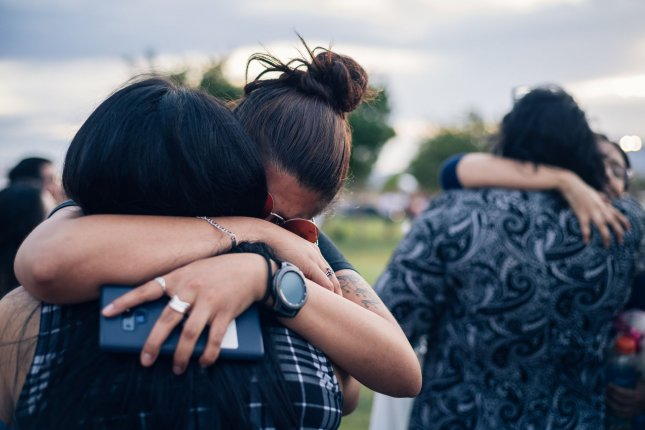 Members of the community mourn at an interfaith vigil on August 4, 2019, in the wake of a mass shooting in El Paso, Texas. File Photo by Justin Hamel/UPI
