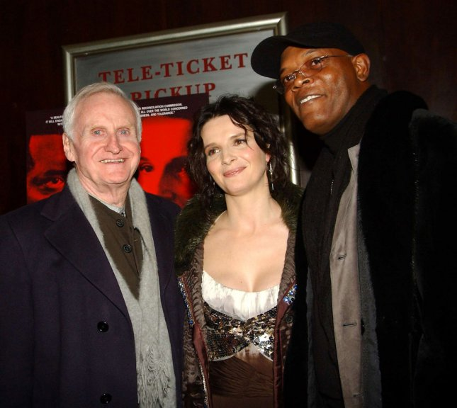 Director John Boorman (left) poses with actors Juliette Binoche and Samuel L. Jackson at the 3/1/05 New York premiere of their new film In My Country directed by John Boorman. (UPI Photo/Ezio Petersen)
