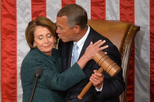 Speaker of the House John Boehner, R-OH, kisses House Minority Leader Nancy Pelosi, D-CA, after he was reelected as the Speaker during the first day of the 114th Congress, inside the House Chambers of the U.S. Capitol Building in Washington, D.C. on January 6, 2015. Photo by Kevin Dietsch/UPI