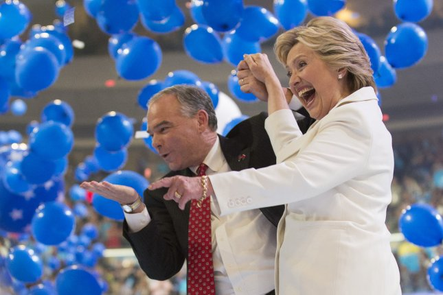 Hillary Clinton and Tim Kaine wave to supporters as a cascade of balloons fall from the roof of Wells Fargo Center in Philadelphia. On Thursday, Clinton made history becoing the first female nominee of a major political party. Photo by Pete Marovich/UPI