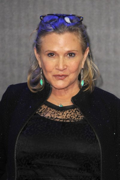 """Carrie Fisher attends the European Premiere of """"Star Wars: The Force Awakens"""" in London on December 16, 2015. Fisher's famous friends are wishing her a speedy recovery after she suffered a heart attack Friday. File Photo by Paul Treadway/UPI"""