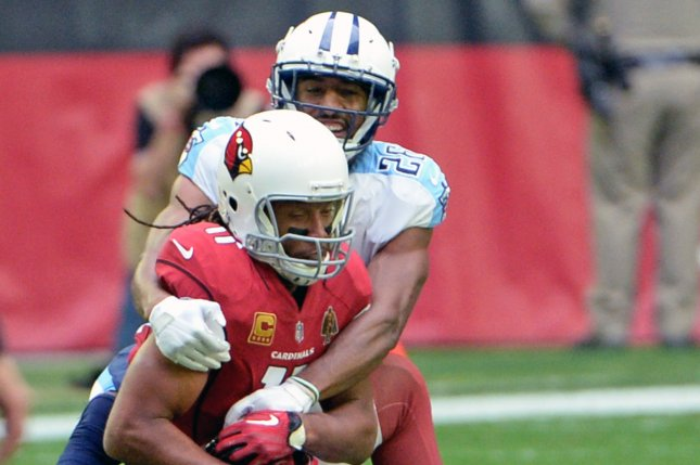 Arizona Cardinals receiver Larry Fitzgerald (11) is tackled by Tennessee Titans cornerback Logan Ryan in the second quarter at University of Phoenix Stadium in Glendale, Arizona December 10, 2017. File photo by Art Foxall/UPI