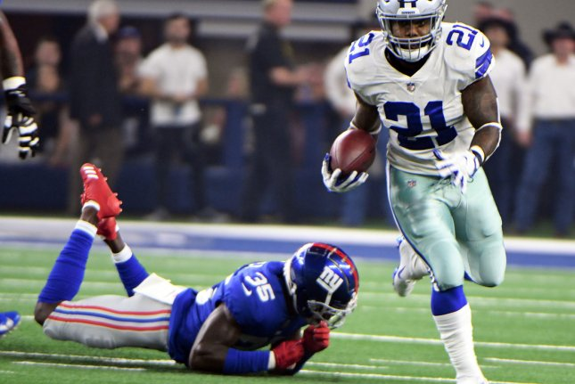 040221dffcd Dallas Cowboys running back Ezekiel Elliott gets away from New York Giants  defender Curtis Riley for a short gain during the first half on Sept.