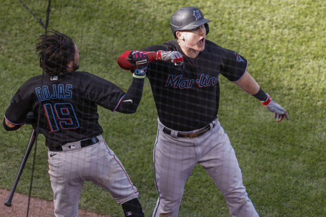 Miami Marlins first baseman Garrett Cooper (26) celebrates with teammate Miguel Rojas (19) after hitting a solo home run against the Chicago Cubs in the seventh inning of the NL Wild Card Series on Friday at Wrigley Field in Chicago. Photo by Kamil Krzaczynski/UPI