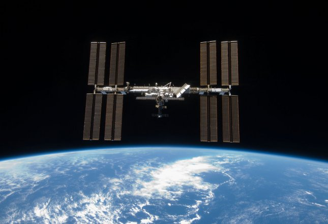 This NASA photo taken by an Astronaut onboard the Space Shuttle Discover shows the International Space Station as the space shuttle separates, March 25, 2009. Earlier the STS-119 and Expedition 18 crews concluded 9 days, 20 hours and 10 minutes of cooperative work onboard the shuttle and station to install a solar array trust onto the station. Space Shuttle Discovery is preparing for its Saturday afternoon return to Earth. (UPI Photo/NASA)