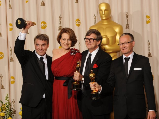 Rick Carter, presenter Sigourney Weaver Robert Stromberg and Kim Sinclair pose with their Oscars for Achievement in Art Director for Avatar during the 82nd Academy Awards in Hollywood on March 7, 2010. UPI/Jim Ruymen