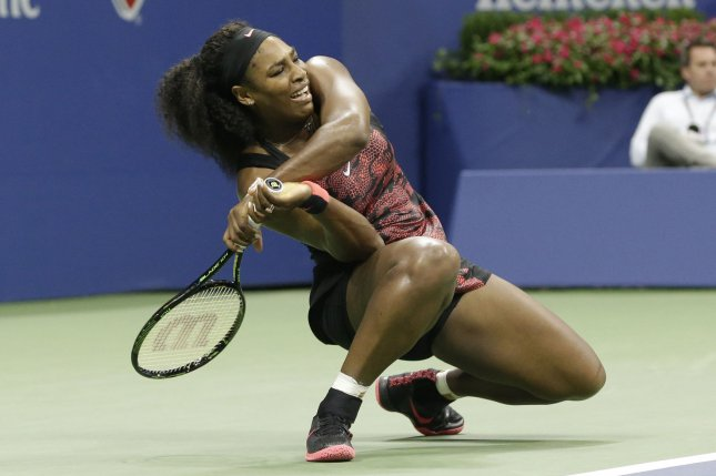 Serena Williams returns a ball to Venus Williams in 3 set victory in the quarter finals in Arthur Ashe Stadium on day 9 at the US Open Tennis Championships at the USTA Billie Jean King National Tennis Center in New York City on September 8, 2015. Serena Williams is trying to become the first woman to win the Tennis Grand Slam since Steffi Graf in 1988. Photo by John Angelillo/UPI