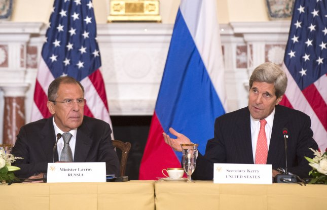 U.S. Secretary of State John Kerry (R) and Russian Foreign Minister Sergey Lavrov at the U.S. State Department in 2013. The interference of those tow nations violate our right to self-determination as individuals, groups and as a nation.File Photo by Kevin Dietsch/UPI