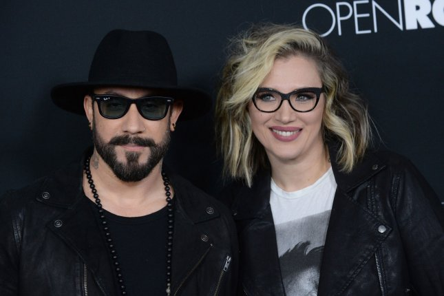 A.J. McLean (L) and wife Rochelle McLean attend the Los Angeles premiere of Fifty Shades of Black on January 26, 2016. The couple welcomed daughter Lyric on Sunday. File Photo by Jim Ruymen/UPI
